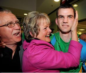 Nolan's mother leads the welcoming party in Dublin Airport last Sunday